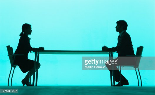Businessman and businesswoman at a table