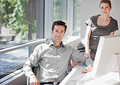 Businessman and businesswoman at computer in office