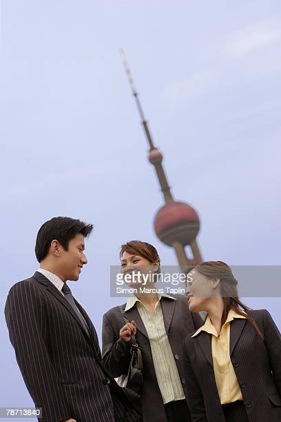 Businessman and Businesswoman Chatting in City