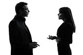 one caucasian couple business woman man in silhouette studio on white background