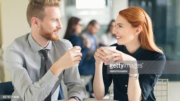 Businessman and businesswoman having coffee break