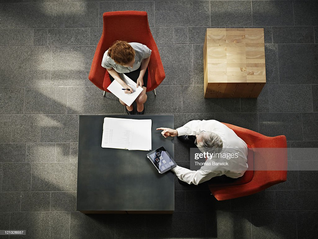 Businessman and businesswoman in meeting in office : Stock Photo