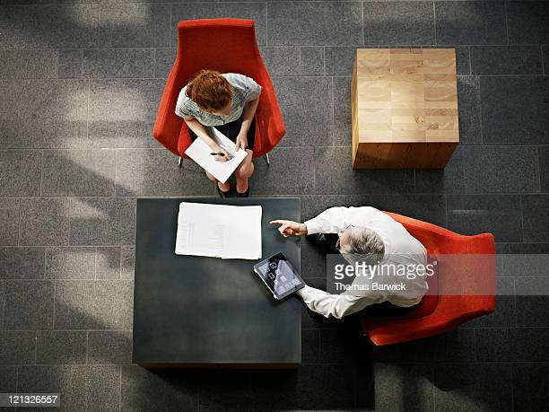 Businessman and businesswoman in meeting in office