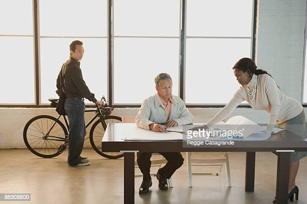 Businessman and businesswoman looking at paperwork together