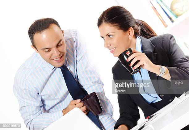 Businessman and businesswoman on business meeting in office