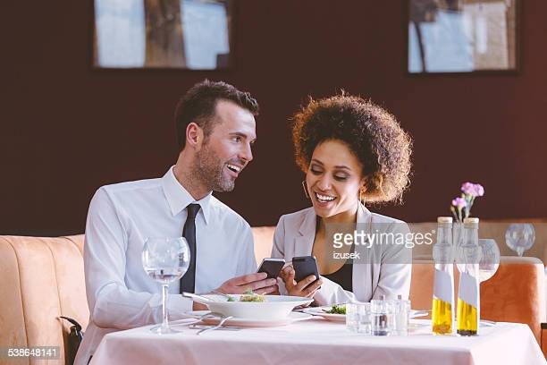 Businessman and businesswoman on lunch