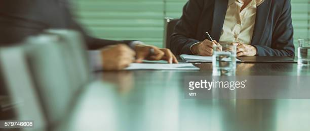 Businessman and businesswoman signing a contract