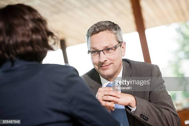 Businessman and businesswoman talking in restaurant