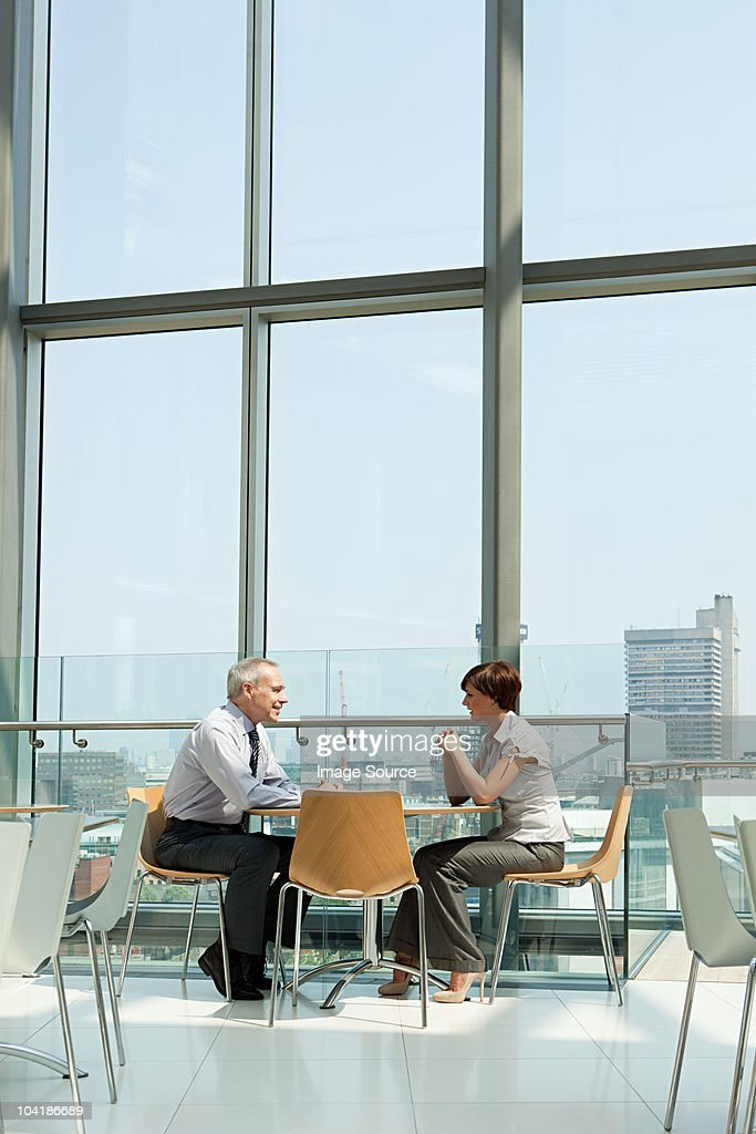 Businessman and businesswoman talking : Stock Photo