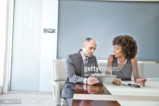 A businessman and businesswoman talking