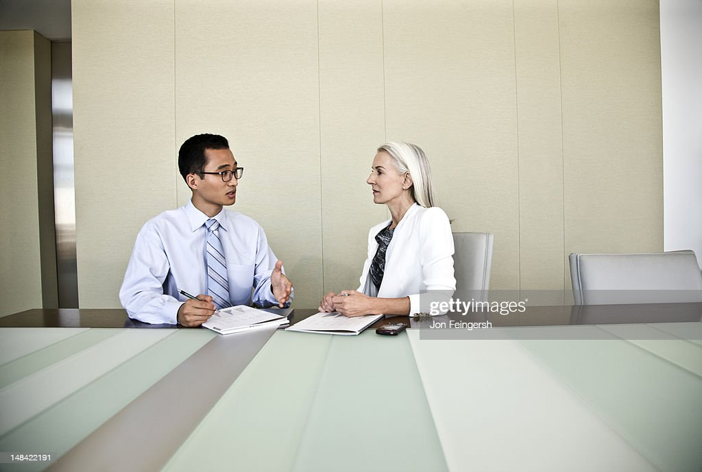 A businessman and businesswoman talking : Stock Photo