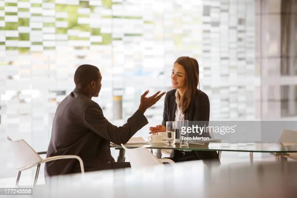 Businessman and businesswoman talking