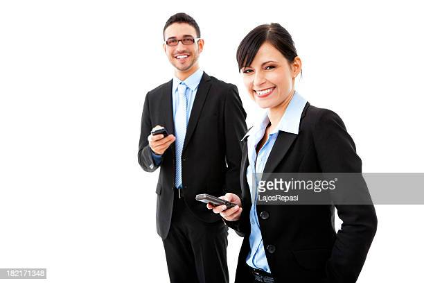 Businessman and businesswoman using mobile phones