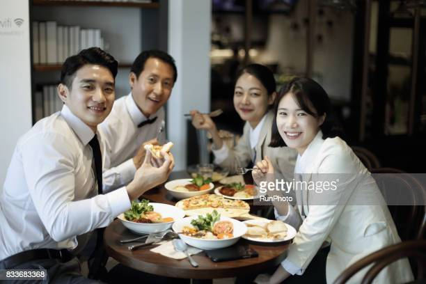 Businessman and businesswoman who is having lunch