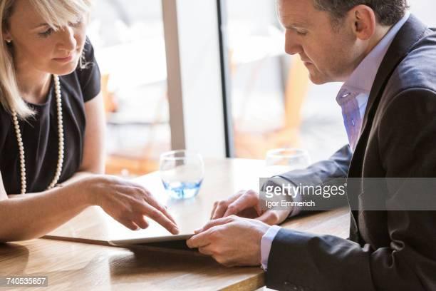 Businessman and businesswoman working