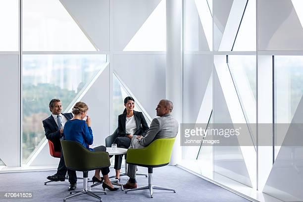 Businessman and businesswomen talking