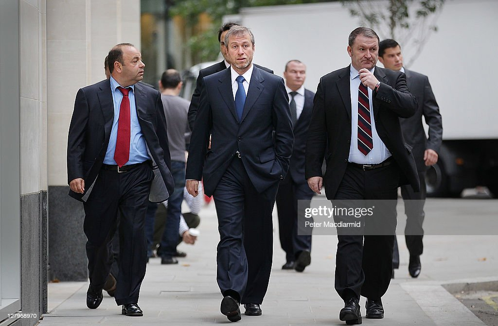 Businessman and Chelsea Football Club owner <a gi-track='captionPersonalityLinkClicked' href=/galleries/search?phrase=Roman+Abramovich&family=editorial&specificpeople=208953 ng-click='$event.stopPropagation()'>Roman Abramovich</a> (C) arrives at The High Court on October 4, 2011 in London, England. Russian businessman Boris Berezovsky is alleging a breach of contract over business deals with Mr Abramovich and is claiming more than £3.2bn in damages.