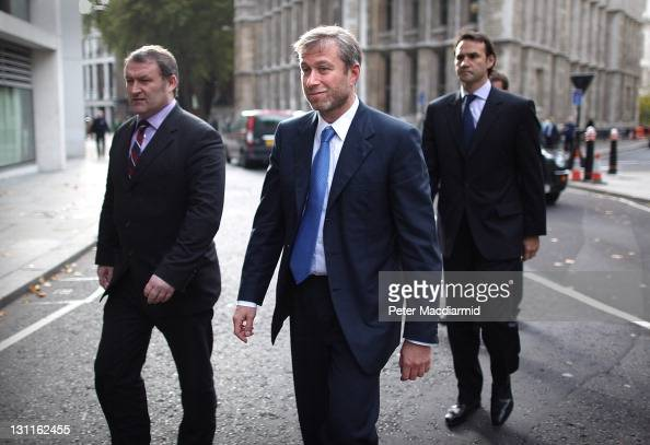 Businessman and Chelsea Football Club owner Roman Abramovich is surrounded by his security team as he leaves The High Court on November 2 2011 in...