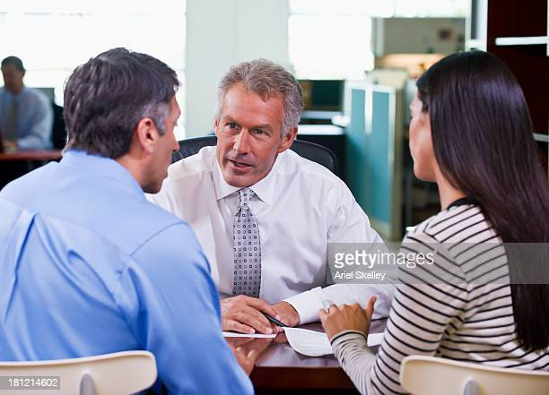 Businessman and clients talking at desk