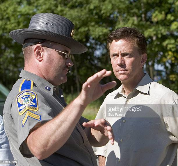 Businessman and Connecticut candidate from Democrats for Senate Ned Lamont from Greenwich CT talks to Connecticut state trooper Sgt Ron Bastura...