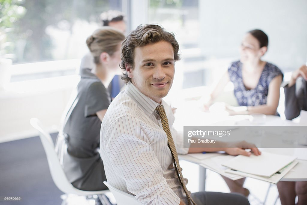 Businessman and co-workers meeting at conference table : Stock Photo