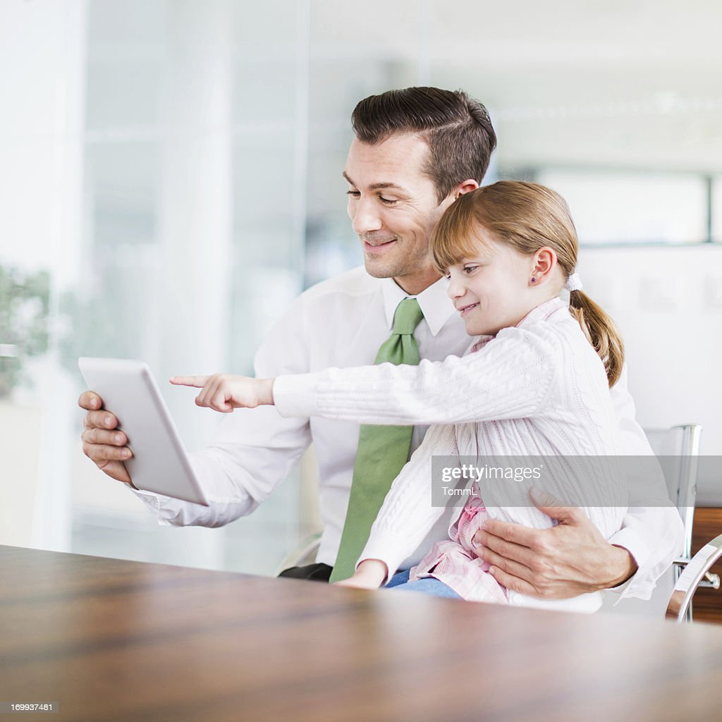 Businessman and Father with Daugther in Office : Stock Photo