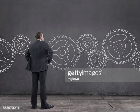 Businessman and Gears : Stock Photo
