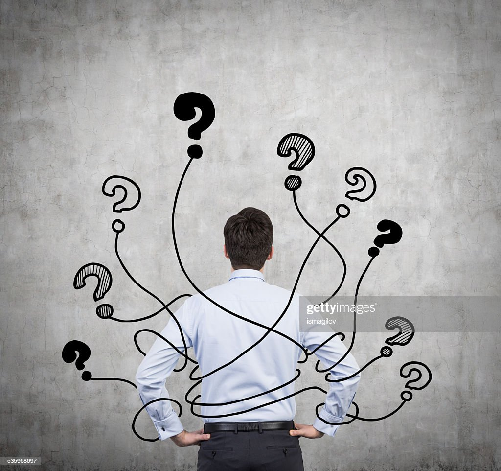 businessman and  question marks : Stock Photo