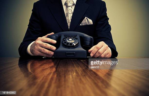 Businessman and retro phone