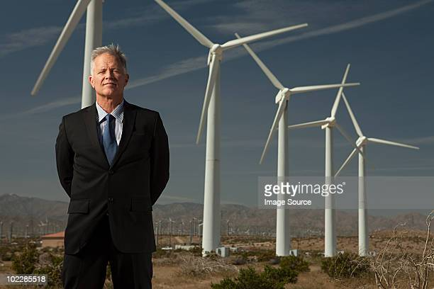Businessman and wind turbines