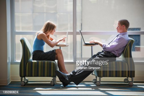 businessman and woman at their laptops : Stock Photo