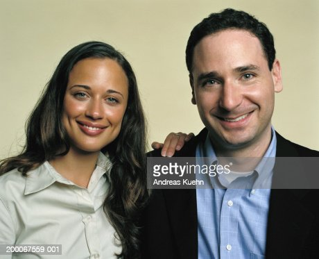 Businessman and woman smiling, portrait, close up : Stock Photo