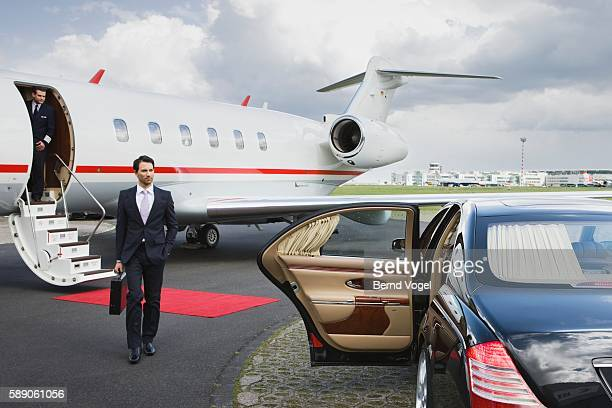 Businessman approaching car at airport
