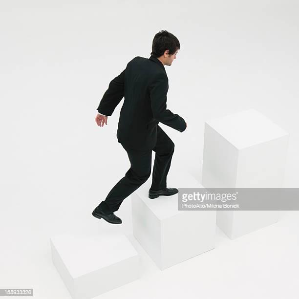 Businessman ascending steps