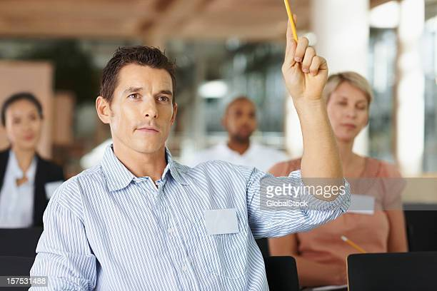 Businessman asking a question in meeting