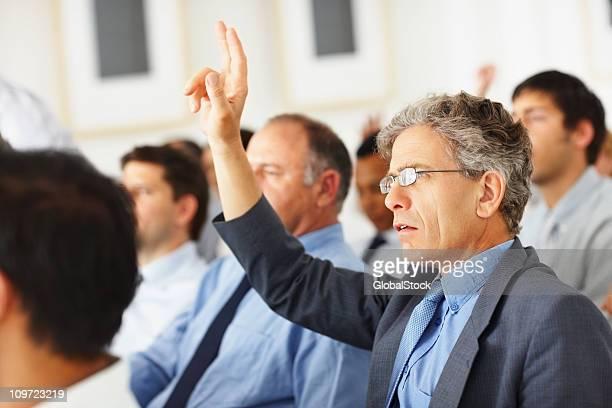 Businessman asking a question