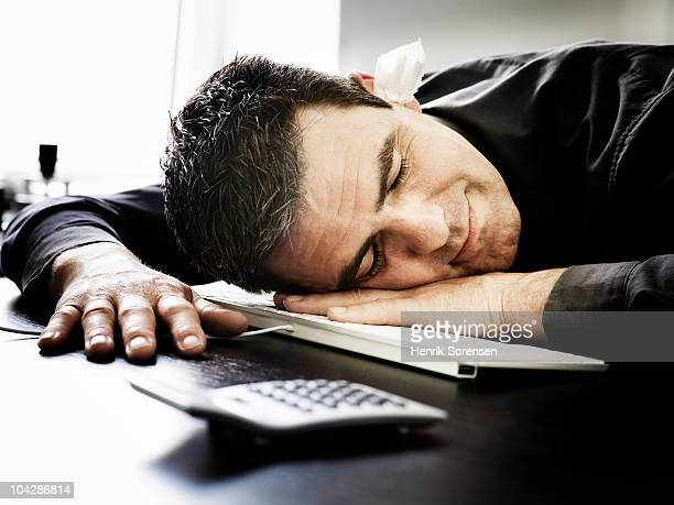 Man Sleeping On Keyboard Photos Et Images De Collection