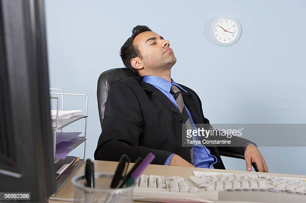 Businessman asleep at his desk
