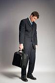 Businessman asleep standing up
