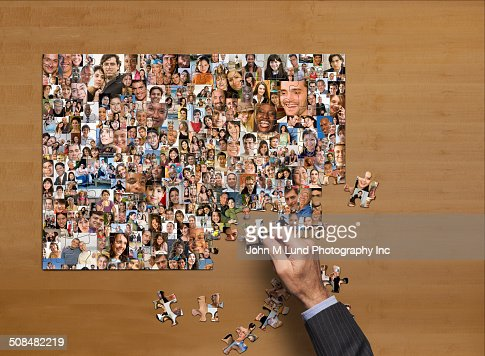 Businessman assembling puzzle of collage of smiling face