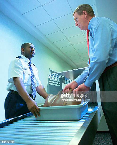 Businessman at airport security checkpoint