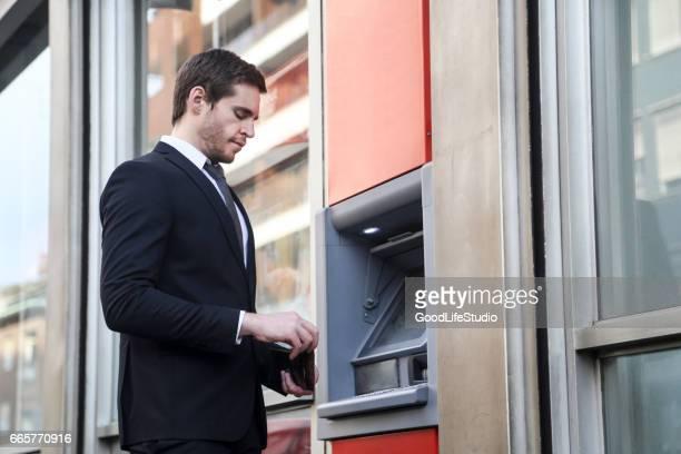 Businessman at an ATM
