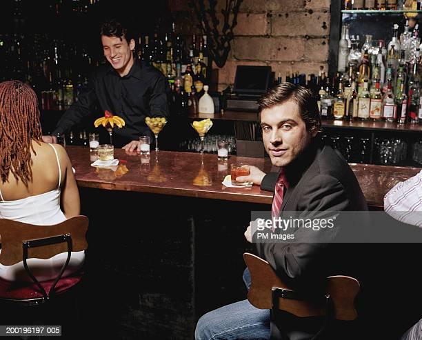 Businessman at bar, portrait