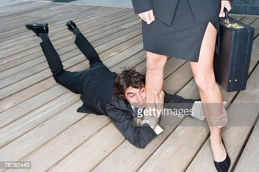 Businessman at Businesswomans Feet