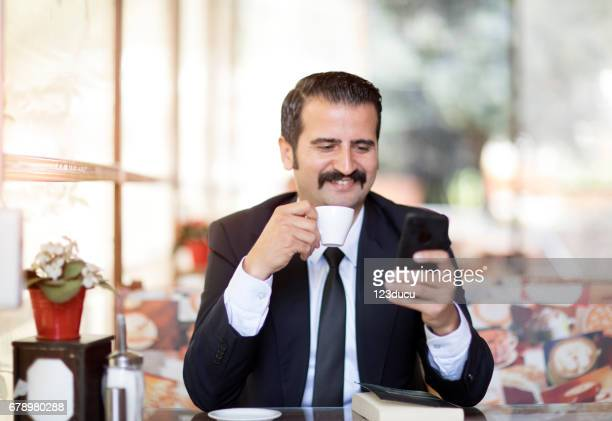 Businessman At Cafe