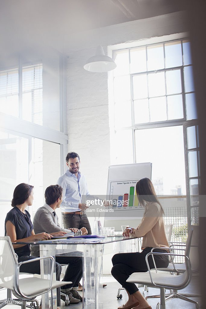 Businessman at chart leading meeting in conference room : Stock Photo
