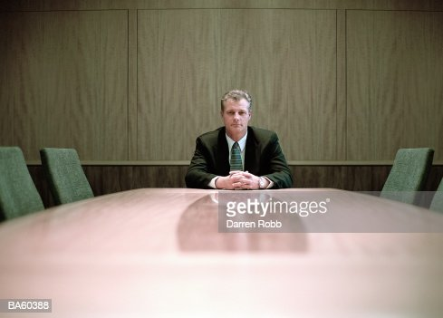 Businessman at conference table, portrait