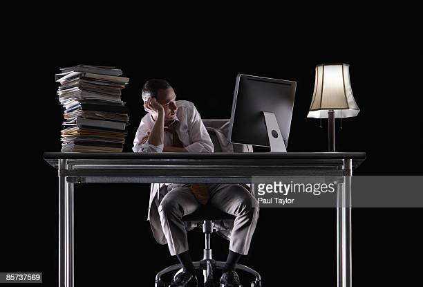 Businessman at desk with unfinished work