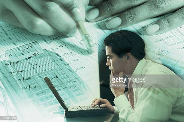 Businessman at laptop superimposed over accounting imagery