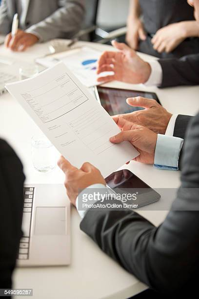 Businessman at meeting reviewing document